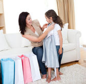 Portrait of a mother and her daughter trying on a dress — Stock Photo