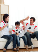 Joyful family watching football match — Stock Photo