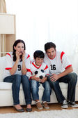 Concentrated family watching football match — Stock Photo
