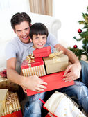 Happy father and son holding Christmas presents — Stock Photo