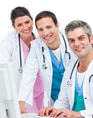 Positive medical team working at a computer — Stock Photo