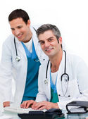 Two male doctors working at a computer — Stock Photo
