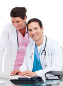 Two jolly doctors working at a computer — Stock Photo