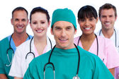 Positive surgeon and his medical team — Stock Photo