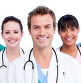 Portrait of a positive medical team against a white background — Stock Photo