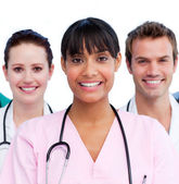 Portrait of a doctor and her medical team — Stock Photo