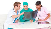 Successful medical team looking at X-ray — Stock Photo