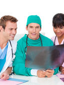 Ambitious medical team looking at X-ray — Stock Photo