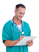 Portrait a handsome male doctor writing notes — Stock Photo