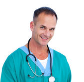 Portrait of a successful male doctor holding a stethoscope — Stock Photo