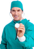 Portrait of an enthusiastic surgeon holding a stethoscope — Stock Photo