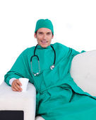 Charismatic surgeon drinking coffee in the staff room — Stock Photo