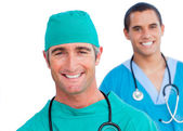 Portrait of smiling male doctors — Stock Photo