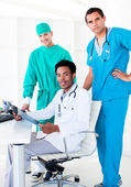 Assertive male doctors looking at X-Ray — Stock Photo