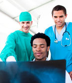 Optimistic male doctors looking at X-Ray — Stock Photo