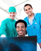 Hopeful male doctors looking at X-Ray — Stock Photo