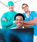Smiling male doctors looking at X-Ray — Stock Photo