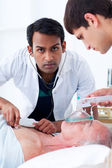 Young Doctors in an emergency unit — Stock Photo
