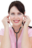 Confident female doctor holding a stethoscope — Stock Photo