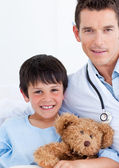 Portrait of a cute little boy and his doctor — Stock Photo