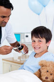Positive doctor giving medicine to a little boy — Stock Photo