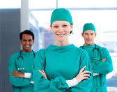 Positive surgeons with folded arms standing — Stock Photo