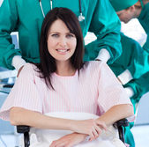 Portrait of a positive patient sitting on a wheelchair — Stock Photo