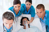 Emergency team carrying a patient — Stock Photo