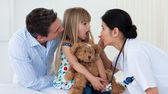 Doctor examining child's throat — Stock Photo