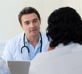 Male doctor explaining diagnosis to a patient — Stock Photo