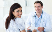 Male doctor giving a prescription to his patient — Stock Photo
