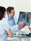 Doctors analyzing an x-ray — Stock Photo