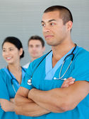 Ethnic doctor with his colleagues in the background — Stock Photo