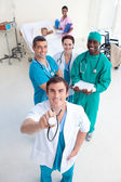 High angle of doctors with stethodcope in a patient room — Stock Photo