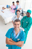 High angle of medical team attending to a young patient — Stock Photo