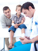 Doctor bandaging a patient's foot — Stock Photo