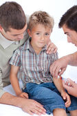 Doctor giving an injection to a child — Stock Photo