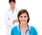 Female doctor smiling at the camera — Stock Photo