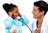 Smiling doctor and his patient playing with a stethoscope — Stock Photo