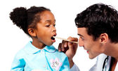 Confident doctor checking his patient's throat — Foto Stock