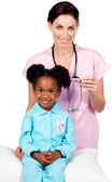 Afro-american little girl attending medical check-up — Stock Photo