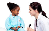 Smiling little girl attending medical check-up — Stock Photo