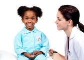 Cute little girl attending medical check-up — Stock Photo