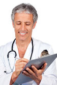Doctor writting documents — Stock Photo