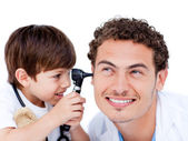 Adorable little boy playing with the doctor — Stock Photo