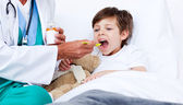 Little boy taking cough medicine — Stock Photo