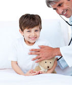 Smiling little boy attending a medical check-up — Stock Photo