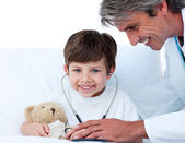Attentive doctor playing with a little boy — Stock Photo