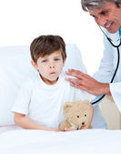 Cute little boy attending a medical check-up — Stock Photo