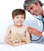 Adorable little boy attending a medical check-up — Stock Photo